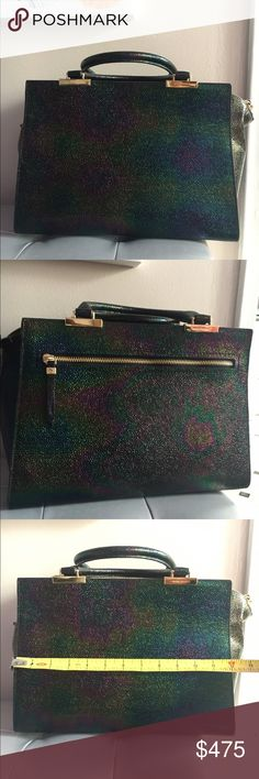 Henri Bendel Petrol Tote Gorgeous bag!!!! Petrol, oil slick, iridescent leather. Stunning bag. My one splurge ever on a bag. Used maybe 12 times. Too big for me and buyers remorse. Lol. henri bendel Bags Totes