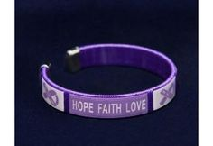 """These Alzheimer's Purple Ribbon Bangle Bracelets have a flexible bangle with purple ribbons and the words """"Hope Faith Love"""". Each Alzheimer's Purple Ribbon Bangle Bracelet is approximately 7 inches. This is a wholesale pack where you get 25 bracelets. Purple Ribbon Awareness, Awareness Ribbons, Cancer Awareness, Alzheimers Awareness, Ribbon Bracelets, Bangle Bracelets, Bangles, Silicone Bracelets, Faith In Love"""