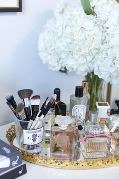 Makeup and perfume vanity station: http://www.stylemepretty.com/living/2016/11/28/this-is-what-closet-dreams-are-made-of/ Photography: Jessica Alexander - http://jessicaalexanderphotography.com/