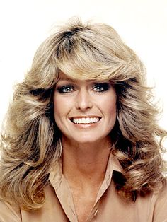 70'S Hair...Farah Fawcett started it all...feathered hair with the blown back look...we all had to have our hair like this lol