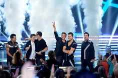 """Joey McIntyre Photos Photos - Finalist Daniel Seavey performs onstage with musicians Danny Wood, Donnie Wahlberg, Joey McIntyre, Jordan Knight, and Jonathan Knight of NKOTB during """"American Idol"""" XIV Grand Finale at Dolby Theatre on May 13, 2015 in Hollywood, California. - 'American Idol' XIV Grand Finale - Show"""
