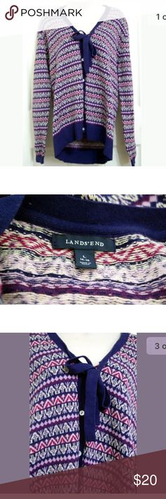 "Purple knit fair isle cardigan Land's End Sweater  Color: Multi Sleeve: Long Sleeve  Embellishment: Tie Neckline, Extra Button Size: Large 95% Cotton, 5% Cashmere Hand Wash Gently used condition. No stains or tears.  Length- 28.5""  Underarm to underarm doubled, laid flat-43""  Sleeve Length-27"" Lands' End Sweaters Cardigans"