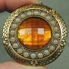 BRASS BUTTON W/ FACETED ORANGE GLASS JEWEL GAY 90's METAL W/ FAUX PEARLS $50.00