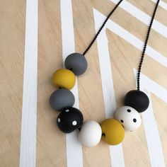 Polymer clay bead necklace black white spot with mustard