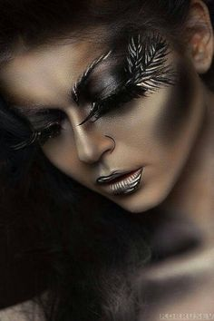 Amazing makeup, this is absolutely gorgeous I love it. The brown tones are cool and the feathers at the corner of the eye are absolutely stunning.