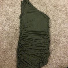 Dark green one sleeve shirt This is a beautiful dark green shirt. Hardly ever worn. Slight markings near the top where it was hung up in the closet. Forever 21 Tops Tank Tops