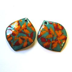 Petals are cut from copper sheet and hammered into shape before the enameling process begins. After a first firing of solid turquoise enamel a second firing is required for the red vines and a third for the orange vines. The backs are black enamel. One hole is drilled in each petal drop. Unique, artistic and very colorful.  This sale is for 2 handmade enamel components as shown in the pictures. c2615  Size: 25 mm x 22 mm wide (1 x 7/8) Vitreous enamel on copper Your cost of shipping is $3.00…
