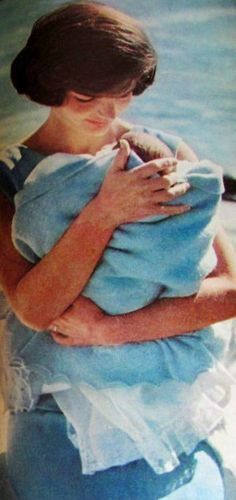 Such a sweet snapshot of Jackie holding one of her sweet babies.