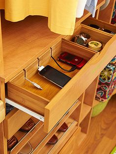 A drop-zone drawer features a charging station for cell phones and iPods and compartments for watches, sunglasses, and spare change. The charging station contains electronics and chargers in one safe and convenient space.