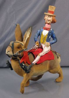 German candy container of Uncle Sam riding a rabbit. This well-detailed piece was probably made around the Spanish American War (1898).