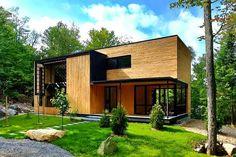 Casa de madera en el corazón del bosque Laurentian