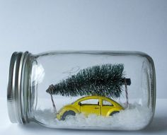 """Cute little idea to capture a Christmas scene in a jar. Might be fun to pick out a favorite Christmas memory or tradition for your family each year and display it in miniature in a jar! Kind of your own """"Christmas village in a jar"""" idea. Christmas Gifts To Make, Noel Christmas, All Things Christmas, Winter Christmas, Holiday Fun, Christmas Crafts, Christmas Decorations, Christmas Vacation, Holiday Decor"""