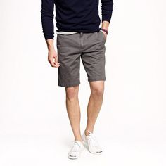 Sweater, shorts & Tennis Shoes.