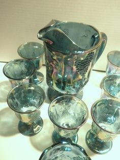 Gorgeous Rare Iridescent Blue harvest Carnival Glass Water Pitcher Set. $175.00, via Etsy.