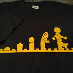 Lovely black tshirt with yellow vinyl Lego mini figures design. Customer order! More info please check out my Etsy shop: southernrebelclothin.etsy.com