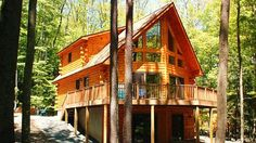 Mountain view or lake view, the mid-sized Black Hawk log home has the glass front and wrap around deck to enjoy it all; 3 bedrooms, 2 baths.