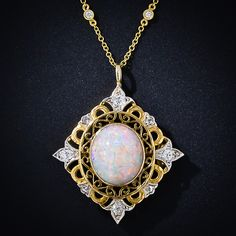 Open-work Pendant Necklace having a beautiful 6.5 carat Opal and old mine-cut and rose-cut Diamonds