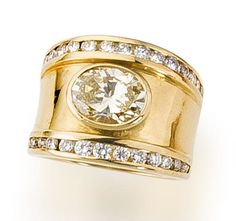 A colored diamond and diamond ring  centering an oval-shaped light yellow diamond within a broad tapered mount detailed with round brilliant-cut diamond borders