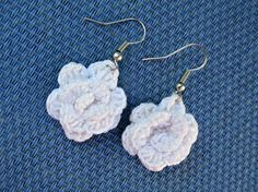 Small and dainty these hand crocheted white rose earrings measure 1 inch and are as unique as a real rose.