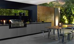 an amazing outdoor kitchen. the contemporary finishes look simple yet elegant.