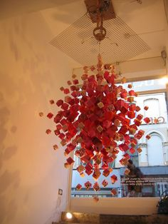 Origami paper installation by Jacqui Symons- this piece begs to live above my dining room table. Origami Cube, Origami Gift Box, Origami Paper, Birthday Table Decorations, New Years Decorations, Christmas Decorations, Holiday Decor, Christmas Tree, Origami Installation