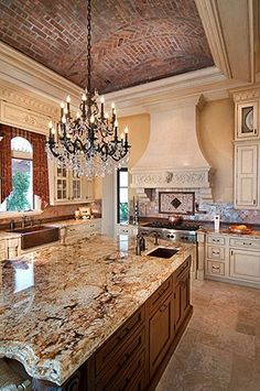 kitchen. love the brick arched ceiling!