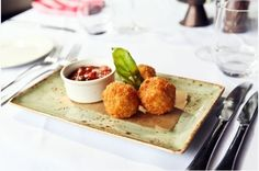 Goat's cheese arancini risotto fritters, tomato and basil salsa