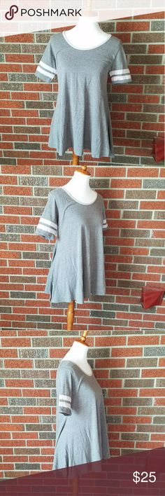 NWOT LuLaRoe Gray Perfect Tee size XS New without tags gray perfect tee from LuLaRoe. Size extra small. Short Sleeve. Has two white lines on each sleeve and a white neckline. LuLaRoe Tops Tunics