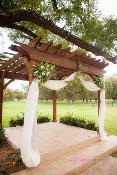 Burlap draping with country pink and green flowers over a wooden image result for tulle canopy over pergola junglespirit Images