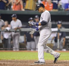 New York Yankees batter Robinson Cano claps for himself as he touches home after hitting the go-ahead home run off of Baltimore Orioles reli...