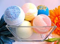 How to Make the Perfect Bath Bomb 8 oz. of baking soda 4 oz. of citric acid 4 oz. of corn starch 4 oz. of Epsom salts (make sure these are fine grained)  ¾ tsp. of water 2 tsp. essential oil 2.5 tsp. almond oil (optional) A few drops of food coloring Round, plastic, snap together dome molds Whisk Bowl and cup for mixing Fluffy towel