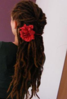 Long beautiful dreads with red rose (shouldn't have cut them you silly!)