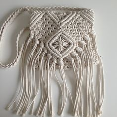 Crossbody macrame handbag with fringe 7 inch made with natural cotton interior lined with zip, flap bag mesurement are approx :: 8 x 8 inch (without fringe) strap mesure 47 inch made in non-smoked and no-pet house