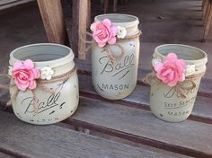 This set of three light tan Mason jars will be a beautiful touch to any bathroom. Set Includes one pint wide mouth holder, a half pint wide mouth holder and a pint size jar . The jars are decorated with twine and dried flowers. Each jar is painted, distressed and sealed. Do not submerge in water, to clean wipe with damp cloth. Great Gift Idea.