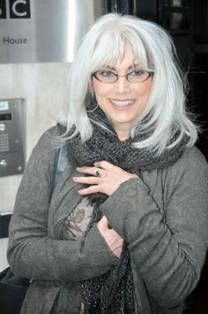 Emmylou Harris - I love how she's never colored her hair. I wish mine would hurry up and go all white.