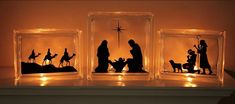 "Nativity - three glass blocks, accented in the photo with a tea light candle behind each, Block sizes 1 - 8""x8"" and 2 - 6""x8"""