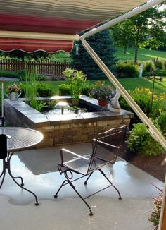 """A Little Piece of Heaven at Home """"You can't even tell it's the same patio!"""" said a reader when she saw this gorgeous makeover: Could you imagine spending a summer afternoon relaxing HERE? Photos showing us adding some landscaping and pond to ou Diy Water Feature, Backyard Water Feature, Small Water Features, Diy Pond, Outdoor Lighting, Outdoor Decor, Outdoor Christmas Decorations, Garden Decorations, Curb Appeal"""