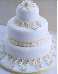 Daisy wedding cake with yellow ribbon