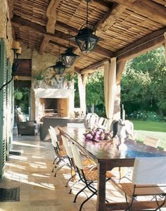 A farmhouse in Provence--shutters, fireplace, curtains to block the sun, long table