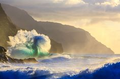 This image from Kauai's Napali coast captures a stunning convergence of the sun setting on crashing waves, and a bird flying by it all! (Photo: Lee Scott)  An early season northwest swell and the position of the autumn sun made this shot possible, Tspectacular.