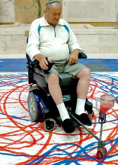 "Arts workshop at Baycrest - clients use motorized wheelchair and unique ""paintbrush"" to create large-scale art."