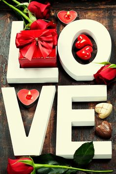 Valentine's day composition - Wooden letters forming word LOVE on wooden background