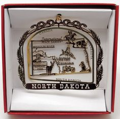 Great Stocking Stuffer - North Dakota State Brass Christmas ORNAMENT Travel Souvenir Gift.  Decorate your tress will the the places you've visited.