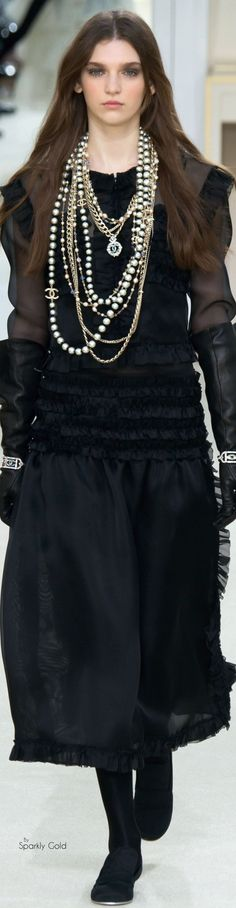 Alexis:  This is totally my vibe...all black with a big tangle of chains and pearls.  Chanel...maybe someday!
