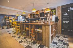 Pom's Kitchen & Deli - Deli/ coffee counter, crate storage, blackboards, industrial stools.