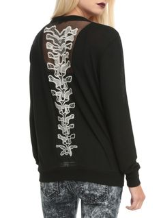 Black lightweight cardigan with a white spine applique on the back.