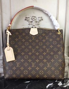 Louis Vuitton Monogram Canvas Graceful PM Beige M43701. The handle is massive and it allows for you to carry the bag in any way possible.  #LouisVuittonBags #MonogramCanvas #GracefulPM #M43701