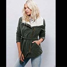 Free People olive green Slim Funnelneck Jacket S Free People olive green (martini) Slim Funnelneck Jacket  Utilitarian twill jacket with an adjustable waist tie and an exposed asymmetrical zip with side zipper pockets.  Soft and comfy ivory french cotton terry lining New Without Tags  *  Size:  Small retail price:  $168.00  *100% Cotton  *Machine Wash Cold  *Import   Measurements for Small: Bust: 42 in = 106 3/4 cm  Waist: 42 in = 106 3/4 cm  Length: 27 1/2 in = 69 3/4 cm  Sleeve Length: 25…