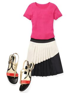 Ladylike style gets livelier, thanks to a pink crewneck and a pleated skirt with a diagonal panel.