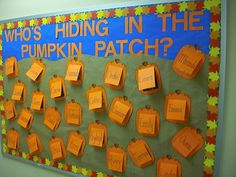 "Bulletin Board, ""Who's Hiding in the Pumpkin Patch?"" with photos of students."